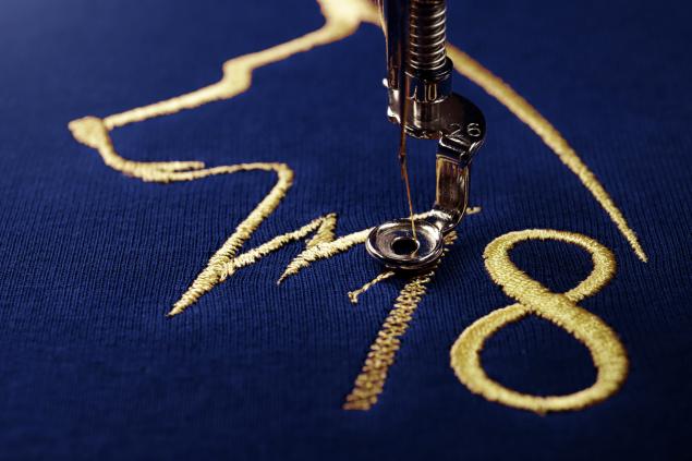 Borduurbedrijf Raalte voorbeeld borduren blauw met goud